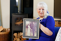 Pictured: Lynne Lewis holding a picture of her wedding in 1976, at her house is Pentwyn near Pontypool, Wales, UK. Sunday 09 December 2018<br /> Re: Lynne Lewis, 66, from Pentwyn, south Wales, whose late husband Thomas John Lewis worked for BT for 42 years and BT keep delaying his pension pay out after his death in early November 2018.
