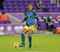 ORLANDO, FL - JANUARY 18: Daniela Arias #3 of Colombia passes the ball during a game between Colombia and USWNT at Exploria Stadium on January 18, 2021 in Orlando, Florida.