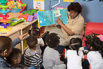 Education Preschool Head Start Early Learn 2s Program teachers and   children in class and   children in class listening to picture book reading, children ages 2-3
