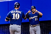 25 March 2019: Milwaukee Brewers infielder Mike Moustakas waits to greet Yasmani Grandal at the plate after Grandal's homer in the 4th inning of an exhibition game against the Toronto Blue Jays at Olympic Stadium in Montreal, Quebec, Canada. The Brewers defeated the Blue Jays 10-5 in the first of two MLB pre-season games in the former home of the Montreal Expos. Mandatory Credit: Ed Wolfstein Photo *** RAW (NEF) Image File Available ***