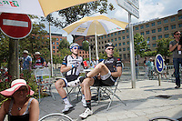 A relaxed Jens Voigt (DEU/Trek Factory Racing) & John Degenkolb (DEU/Giant-Shimano) wait for the peloton to start the last stage of the 2014 Tour de France.<br /> The go is actually given at this point, but Voigt wishes to   savor the moment as this will be his very last TDF stage ever... after participating in 17(!) editions.<br /> <br /> 2014 Tour de France<br /> stage 21: Evry - Paris Champs-Elysées (137km)