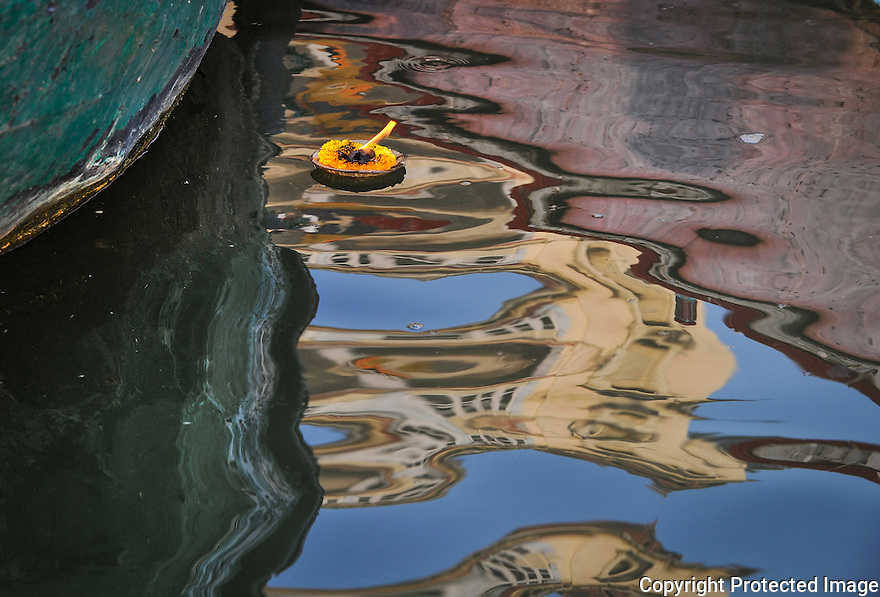 Flower in suface reflections in the river Ganges in Varanasi India