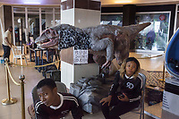Nigeria. Enugu State. Enugu. Town center. Shoprite Mall. Igbo man and woman looking after a prehistoric animal. Visitors' attraction. A written sign says: Please do not touch. Enugu is the capital of Enugu State, located in southeastern Nigeria. 28.06.19 © 2019 Didier Ruef