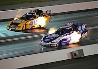 Jun. 17, 2011; Bristol, TN, USA: NHRA funny car driver Robert Hight (right) alongside Ron Capps during qualifying for the Thunder Valley Nationals at Bristol Dragway. Mandatory Credit: Mark J. Rebilas-