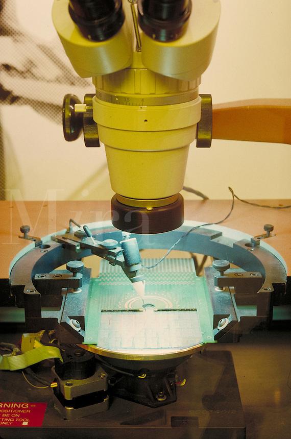 Computer wafer etching demonstration exhibit at Technology Museum, San Jose, California. Robotics. Technology. Computers. Manufacturing. Machinery. San Jose California.