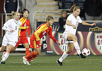 Lauren Cheney #12 of the USA WNT controls the ball in front of Jun Ma #13 of the PRC WNT during an international friendly match at PPL Park, on October 6 2010 in Chester, PA. The game ended in a 1-1 tie.