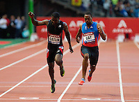 06 JUL 2012 - PARIS, FRA - Tyson Gay of the USA (right) beats Justin Gatlin of the USA (left) to the finish line during the men's 100m race at the 2012 Meeting Areva held in the Stade de France in Paris, France (PHOTO (C) 2012 NIGEL FARROW)
