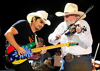 06 July 2020 - Country music and southern rock legend Charlie Daniels has passed away after suffering a stroke. The Grand Ole Opry member and Country Music Hall of Famer was 83. File Photo: 09 June 2013 - Nashville, Tennessee - Brad Paisley, Charlie Daniels. 2013 CMA Music Festival Nightly Concert held at LP Field. Photo Credit: Mike Strasinger/AdMedia