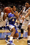 Kentucky guard Rajon Rondo (4) is guarded by Connecticut forward Rudy Gay (22).  Connecticut defeated Kentucky 87-83 in the second round of the NCAA Tournament  at the Wachovia Center in Philadelphia, Pennsylvania on March 19, 2006.