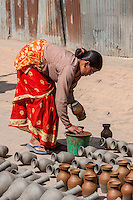 Bhaktapur, Nepal.  Potter at Work in Potters' Square.