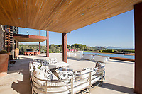 BNPS.co.uk (01202) 558833. <br /> Pic: Hamptons/BNPS<br /> <br /> Pictured: Outside seating.<br /> <br /> A stunning villa where Love Island was filmed is on the market for £5.94m.<br /> <br /> Fans of the show - where singletons live together and couple up to stay in the villa and win a cash prize - might recognise this beautiful home from the Australian spin-off.<br /> <br /> The elegant six-bedroom property, which has a pool and a vineyard, was used in the first series of the Australian version, filmed in 2018 but only aired in the UK last year.