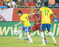 Brazil defender Maxwell (14) intercepts the ball from Portugal forward Nani (17).  In an International friendly match Brazil defeated Portugal, 3-1, at Gillette Stadium on Sep 10, 2013.