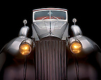 A grey 1930's Packard.