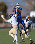 Carson's Connor Pradere goes up for a reception against Reed defenders Dylan Morell and Logan Marcantonio during the NIAA D-1 Northern Regional title game at Bishop Manogue High School in Reno, Nev., on Saturday, Nov. 29, 2014. Reed won 28-25.<br /> Photo by Cathleen Allison