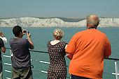 A P&O Dover-Calais ferry passes the white cliffs of Dover.