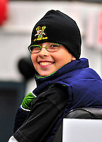 9 October 2009: University of Vermont Catamount fan and Member of Rally's Roundup Kid's Club Josh Wolfstein gets an opportunity to ride the Zamboni ice resurfacing vehicle between periods at a UVM women's hockey game against the Union Dutchwomen at Gutterson Fieldhouse in Burlington, Vermont. The Catamounts shut out the visiting Dutchwomen 2-0 to start off the Cats' 2009 season. Mandatory Credit: Ed Wolfstein Photo