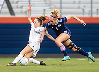 Kayla Hurley (11) of Bentonville of and Ally Ribar (1) of Rogers Heritage battle for the ball at David Gates Stadium, Rogers, Ark., on Tuesday,, March 30, 2021  / Special to NWA Democrat-Gazette/ David Beach
