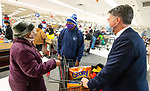 WATERBURY, CT-122220JS02- Customer Sally Riddick of Waterbury, thanks Kristopher Reese, Pastor at Grace Baptist Church in Waterbury and store store owner Paul Tornaquindici, right,  after Rev. Reece surprised her and paid for her groceries Tuesday at the ShopRite of Waterbury. <br />