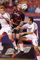 The MetroStars' Jeff Parke goes up for a header between D.C. United's Bryan Namoff, and Mike Petke. D.C. United defeated the MetroStars 1 to 0 in regular season MLS action on Saturday October 2, 2004 at Giant's Stadium, East Rutherford, NJ..