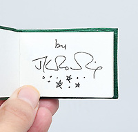 BNPS.co.uk (01202) 558833<br /> Pic: PeterHarrington/BNPS<br /> <br /> JK Rowling's signature<br /> <br /> A unique miniature Harry Potter book created by JK Rowling has emerged for sale for £125,000.<br /> <br /> The author hand-wrote and illustrated the 31 page green leather bound manuscript measuring just 1.5ins by 2.5ins for a charity auction in 2004.<br /> <br /> It contains the passage on pages 52-53 of Harry Potter and The Philosopher's Stone where Harry and Hagrid go to London to buy school supplies for Hogwarts.<br /> <br /> Rowling has done original drawings of equipment including quills, scales, a cauldron and a wizard's hat.