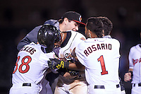 Rochester Red Wings left fielder Adam Walker (30) is mobbed by teammates including Stephen Wickens (38) and Eddie Rosario (1) after a walk off base hit during a game against the Columbus Clippers on June 14, 2016 at Frontier Field in Rochester, New York.  Rochester defeated Columbus 1-0.  (Mike Janes/Four Seam Images)