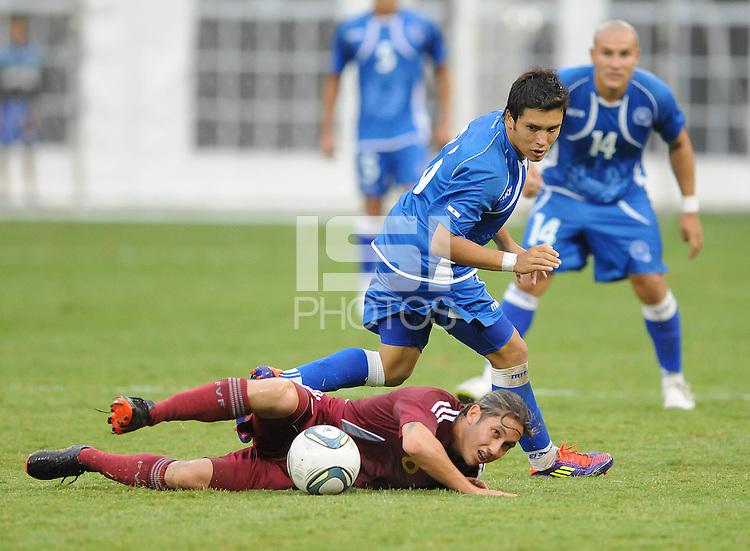 Venezuela midfielder Angel Flores (6) gets fouled by EL Salvador midfielder Jaime Alas (16). El Salvador National Team defeated Venezuela 3-2 in an international friendly at RFK Stadium, Sunday August 7, 2011.