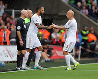 Pictured L-R: Kyle Bartley of Swansea substitutes team mate Jonjo Shelvey Sunday 30 August 2015<br /> Re: Premier League, Swansea v Manchester United at the Liberty Stadium, Swansea, UK