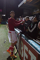 Joao Nunes of SL Benfica hands his shirt to a young supporter after the match during the Premier League U21 International Cup match between Celtic U21 and Benfica U21 at Adams Park, High Wycombe, England on 24 September 2015. Photo by Andy Rowland.