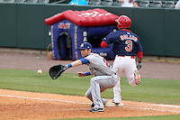 Round Rock Express first baseman Chad Tracy #28 catches a throw as Donavan Solano #3 is safe during a game versus the Memphis Redbirds at Autozone Park on April 30, 2011 in Memphis, Tennessee.  Memphis defeated Round Rock by the score of 10-7.  Photo By Mike Janes/Four Seam Images