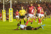 Ugo Monye of Harlequins dives over to score his first try during the Aviva Premiership match between Harlequins and London Welsh at the Twickenham Stoop on Friday 7th September 2012 (Photo by Rob Munro)