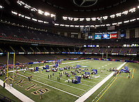 A wide angle shot of players talking with the reporters during BCS Media Day at Mercedes-Benz Superdome in New Orleans, Louisiana on January 6th, 2012.