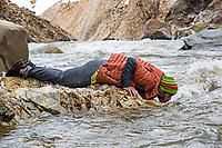 Lucho Birkner drinks from river in Valle de los Condores, Chile
