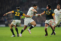 Ben Te'o of England goes past Johan Goosen and Warren Whiteley of South Africa during the Old Mutual Wealth Series match between England and South Africa at Twickenham Stadium on Saturday 12th November 2016 (Photo by Rob Munro)
