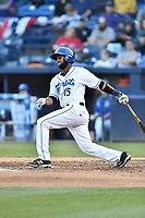 Asheville Tourists catcher Hedekel Gonzalez (15) swings at a pitch during a game against the Columbia Fireflies at McCormick Field on April 13, 2018 in Asheville, North Carolina. The Tourists defeated the Fireflies 5-1. (Tony Farlow/Four Seam Images)
