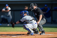 Bluefield Blue Jays catcher Ridge Smith (4) reaches for a pitch as home plate umpire Mark Stewart looks on during the game against the Burlington Royals at Burlington Athletic Stadium on June 26, 2016 in Burlington, North Carolina.  The Blue Jays defeated the Royals 4-3.  (Brian Westerholt/Four Seam Images)