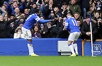 Pictured: Romelu Lukaku of Everton (L) celebrating his goal with team mate Kevin Mirallas (R). Saturday 22 March 2014<br /> Re: Barclay's Premier League, Everton v Swansea City FC at Goodison Park, Liverpool, UK.