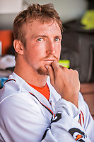 30 July 2017: Washington Nationals pitcher Erick Fedde looks out from the dugout during his major league debut against the Colorado Rockies at Nationals Park in Washington, DC. The Rockies defeated the Nationals 10-6 in the second game of their 3-game weekend series. Mandatory Credit: Ed Wolfstein Photo *** RAW (NEF) Image File Available ***