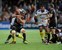 Alistair Hargreaves of Saracens tussles with Sébastien Vahaamahina of ASM Clermont Auvergne during the European Rugby Champions Cup  Round 1 match between Saracens and ASM Clermont Auvergne at the Twickenham Stoop on Saturday 18th October 2014 (Photo by Rob Munro)