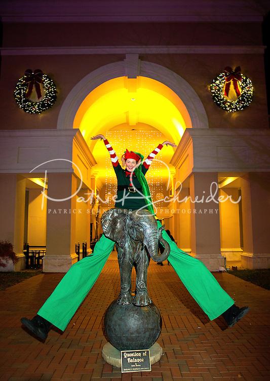 Charlotte Christmas Events - Photography of the Phillips Place Winter Wonderland Christmas event in Charlotte, North Carolina.<br /> <br /> A holiday stilt walker having fun entertaining the children at Charlotte holiday Christmas event.<br /> <br /> Charlotte Photographer - PatrickSchneiderPhoto.com