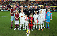 Pictured: Children mascots with team captains Kevin Nolan for West Ham, Ashley Williams for Swansea, refree Michael Dean, s Butt, E Smart Saturday 10 January 2015<br /> Re: Barclays Premier League, Swansea City FC v West Ham United at the Liberty Stadium, south Wales, UK