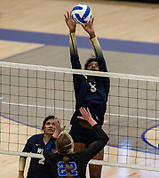 Trinity Luckett (5) of Bentonville West  up high with the block against Rogers at Rogers High School, Rogers, AR, on Thursday, September 9, 2021 / Special to NWADG David Beach