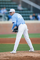 North Carolina Tar Heels relief pitcher Rodney Hutchison Jr. (48) looks to his catcher for the sign against the Kentucky Wildcats at Boshmer Stadium on February 17, 2017 in Chapel Hill, North Carolina.  The Tar Heels defeated the Wildcats 3-1.  (Brian Westerholt/Four Seam Images)