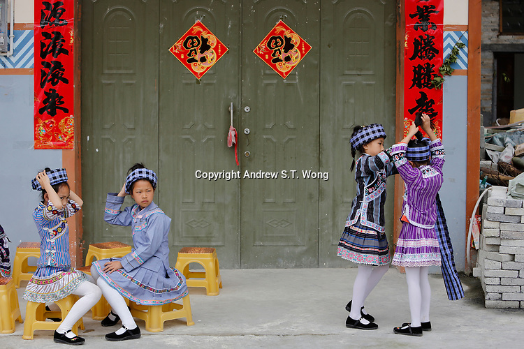 Girls of the ethnic Bouyei Tribe put on traditional headdress at Wangmo County in China's southwestern Guizhou Province, April 2019.