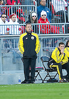October 16 2010 Columbus Crew head coach Robert Warzycha watches the action during a game between the Columbus Crew and Toronto FC at BMO Field in Toronto..The final score was a 2-2 draw.