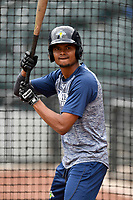 Outfielder Jose Miguel Medina (12) of the Columbia Fireflies works a bunting drill before a game against the Charleston RiverDogs on Friday, April 5, 2019, at Segra Park in Columbia, South Carolina. Charleston won, 6-1. (Tom Priddy/Four Seam Images)