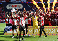 Ivan Toney leads the celebrations as Brentford win the Championship Trophy and promotion to the Premier League during Brentford vs Swansea City, Sky Bet EFL Championship Play-Off Final Football at Wembley Stadium on 29th May 2021