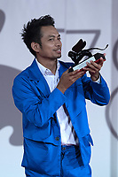 """Director Neang Kavich receives the Best Actor Orizzonti Award on behalf of Piseth Chhun for """"White Building"""" during the Winners Red Carpet as part of the 78th Venice International Film Festival in Venice, Italy on September 11, 2021. <br /> CAP/MPI/IS/PAC<br /> ©PAP/IS/MPI/Capital Pictures"""