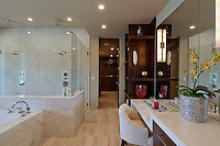 Stock photo of large luxury master bath with double shower