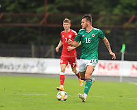 8th September 2020; Ballymena Showgrounds, Ballymena, Antrim County, Northern Ireland; UEFA Under 21s Championship Qualifier, Group B, Northern Ireland versus Denmark; Jake Dunwoody of Northern Ireland looks for a passing outlets as he brings the ball forward