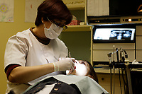 Montreal QC CANADA - March 2006 file Photo - Model Released Photo - Employees at work in Dr Mario Bessette Dental Clinic